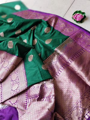 Pure kataan silk in bottle green with purple border and zari booties
