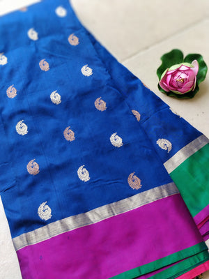 Blue katan silk saree with golden booties all over and pink border