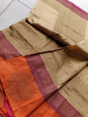 Pure katan silk in cream with wide orange border on one side