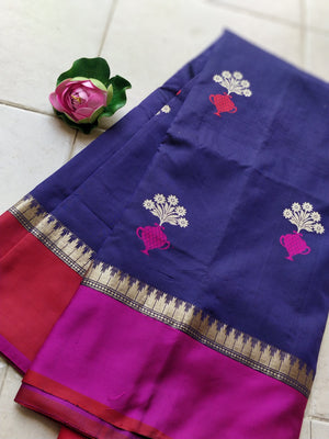 Purple katan silk saree with pink and red border with golden flowers all over