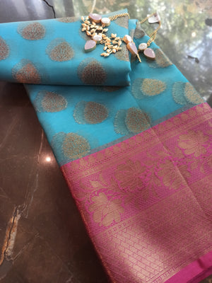 Sky blue kora saree with golden zari weaving on pink border and booties allover