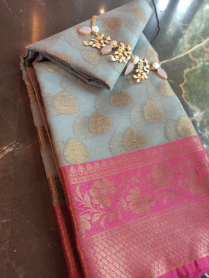 Grey kora saree with golden zari weaving on pink border and booties allover