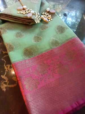 Green kora saree with golden zari weaving and booties allover