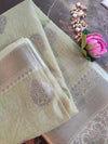 Silver booties and pink border on pastel green linen saree