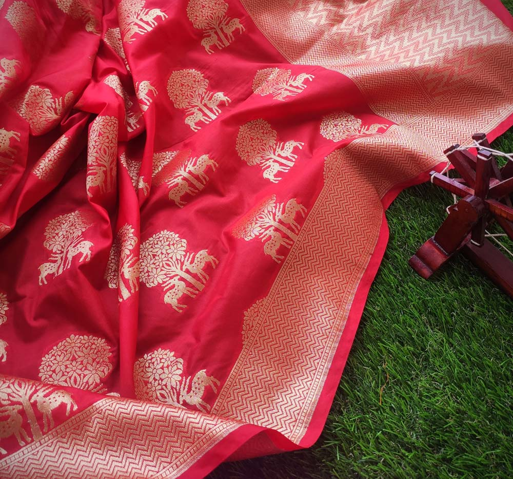 Orangish Red silk saree with golden zari weaving of trees