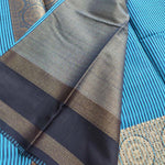 Vertical lines of blue and black chanderi saree with zari border, brocade annachal and blouse