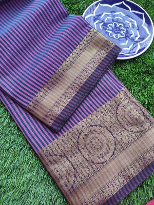 Vertical lines of fuschia purple and black chanderi saree with zari border, brocade anchal and blouse