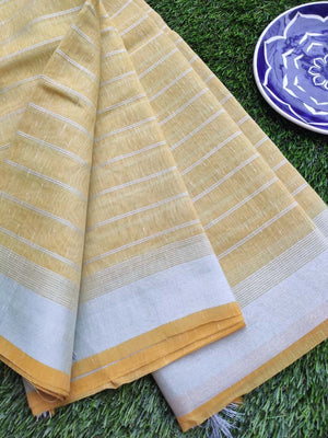 Horizontal lines in silver on yellow  linen saree & silver zari border