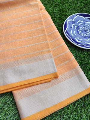 Horizontal lines in silver on bright orange linen saree & silver zari border