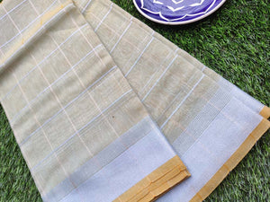 Broad checks of silver on Pastel green linen saree & silver zari border