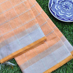 Broad checks of silver on bright orange linen saree & silver zari border