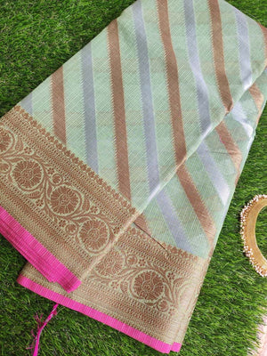 Diagonal zari lines allover on pista green kota with zari border & brocade blouse