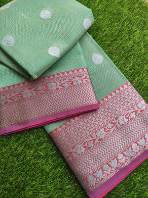 Silver border on dull green kota saree with silver booties allover