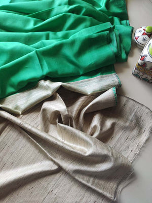 Light green munga silk with pure tusser aanchal and striped tusser blouse