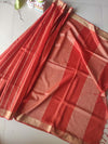 Pure munga silk in rust orange with light zari vertical lines