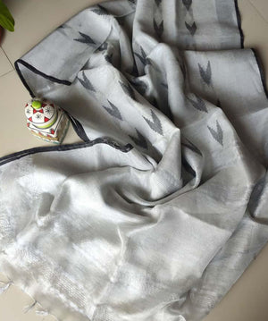 Silver tissue linen saree with black border and booties allover