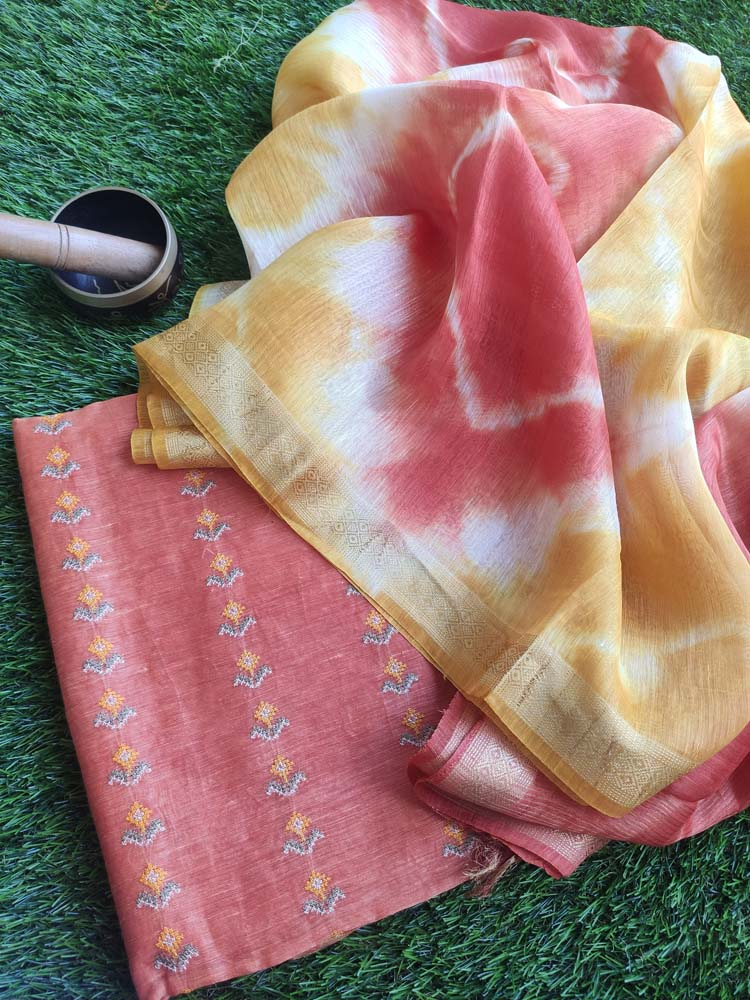 Rust orange linen tusser suit material with overall embroidery and contrasting linen dupatta