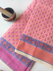 Allover floral multicolor woven booties on cream kora sarees & orange & pink border