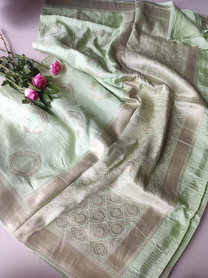 Beautiful pista green silk with circular golden motifs allover & checks at the end, gold zari border and intricate aanchal