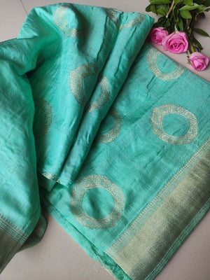 Beautiful green silk with circular golden motifs allover & checks at the end, gold zari border and intricate aanchal