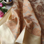 Cream kora saree with floral jaal of brown resham & gold zari border