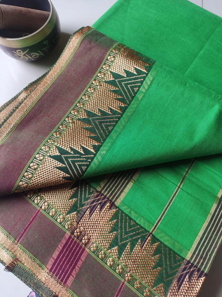 Bright green narayanpet south cotton saree with small temple resham border