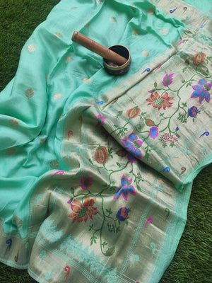 Paithani zari border and aanchal on green silk saree with zari booties allover