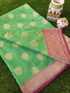 Green silk with light gold zari leaves allover and zari on magenta border