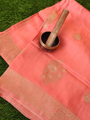Soothing peach soft silk with light gold zari leaves allover and zari border
