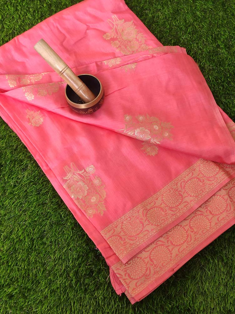 Soothing pink soft silk with light gold zari leaves allover and zari border