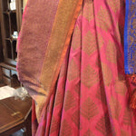 Pink silk with light gold zari leaves allover and zari border