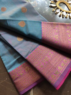 Small checks on blue chanderi with pink zari border and zari booties allover