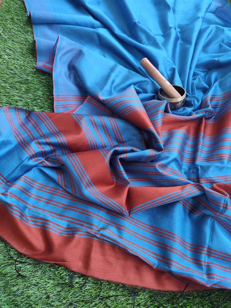 Blue Kora silk saree with rust striped border & aanchal