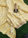 Beautiful yellow silk with circular golden motifs allover & checks at the end, gold zari border and intricate aanchal