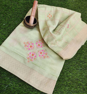 Beautiful light green silk with colorful floral motifs allover & checks  gold zari border and intricate aanchal