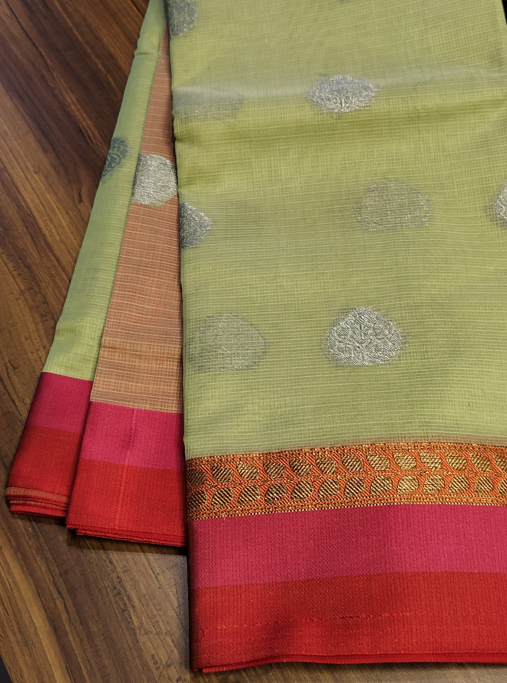 Light pista green kota saree with bright pink border and silver zari butties allover