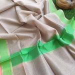 Light brown pure linen lightweight dupatta with gold and bright green border.