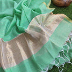 Light green linen dupatta with gold stripes & tassels at end