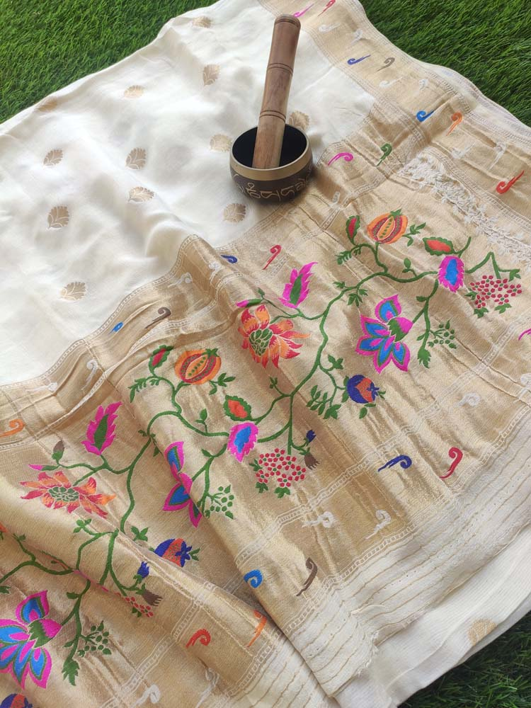 Beautiful white silk with paithani border and aanchal, zari booties allover