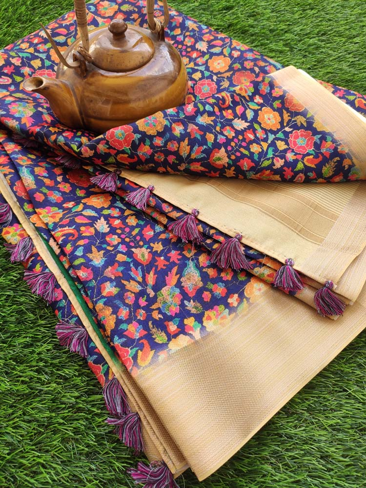 Digital printed florals on blue linen saree with golden zari border