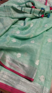 Light sea green pure linen saree with allover small flower embroidery