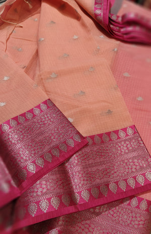 Peach kota saree with pink border and silver zari weaving