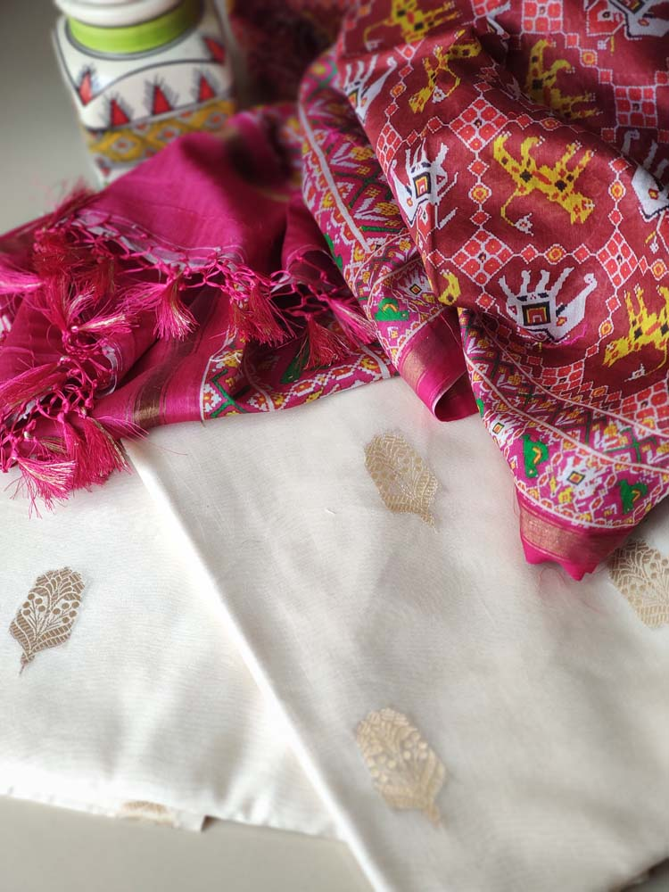 Offwhite cotton dress material with golden booties and patola printed pink dupatta