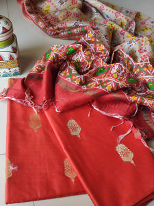 Orange cotton dress material with golden booties and patola printed light brown dupatta
