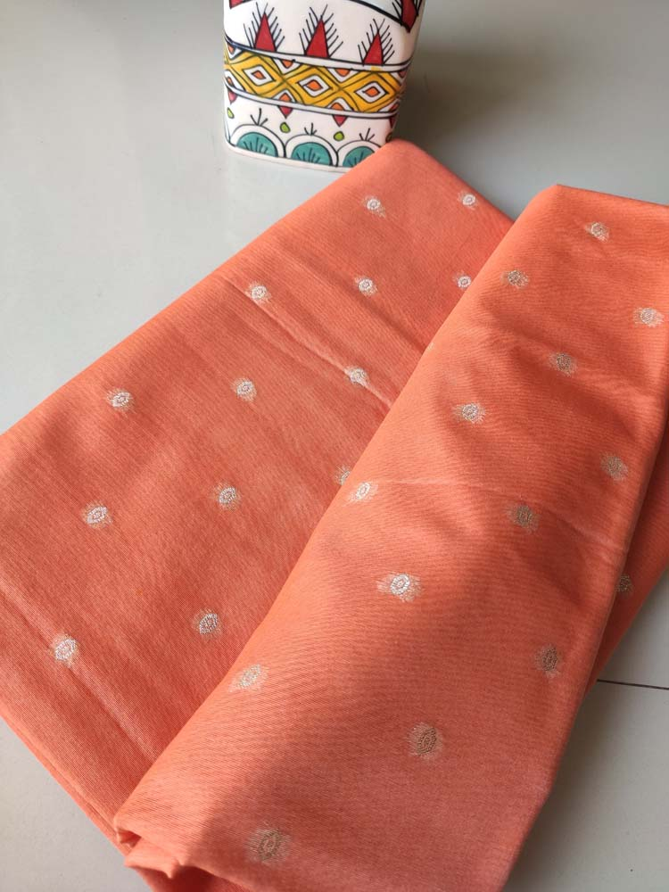 Orange chanderi dress material with woven big booties and shaded zari woven jaal on dupatta