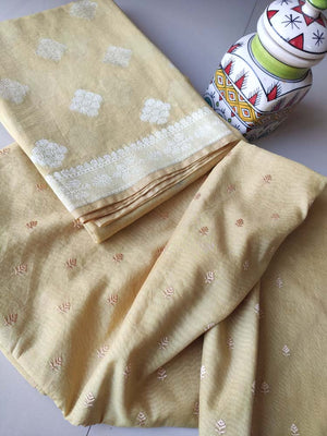 Light yellow chanderi dress material with embroiderery booties and zari woven dupatta