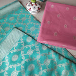 Peach chanderi dress material with woven booties and sea green zari woven jaal on dupatta