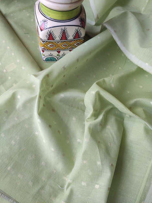 Pista green chanderi dress material with woven booties and peach zari woven jaal on dupatta