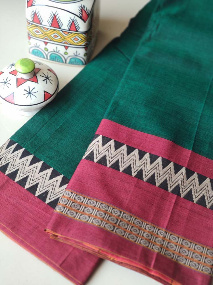 Green narayanpet south cotton saree with resham zigzag border