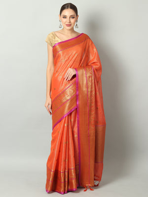 Orange shimmer zari linen saree with antique gold zari booties and border